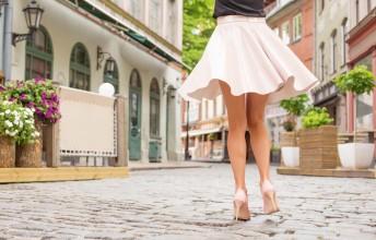 Cheerful woman dancing on the street